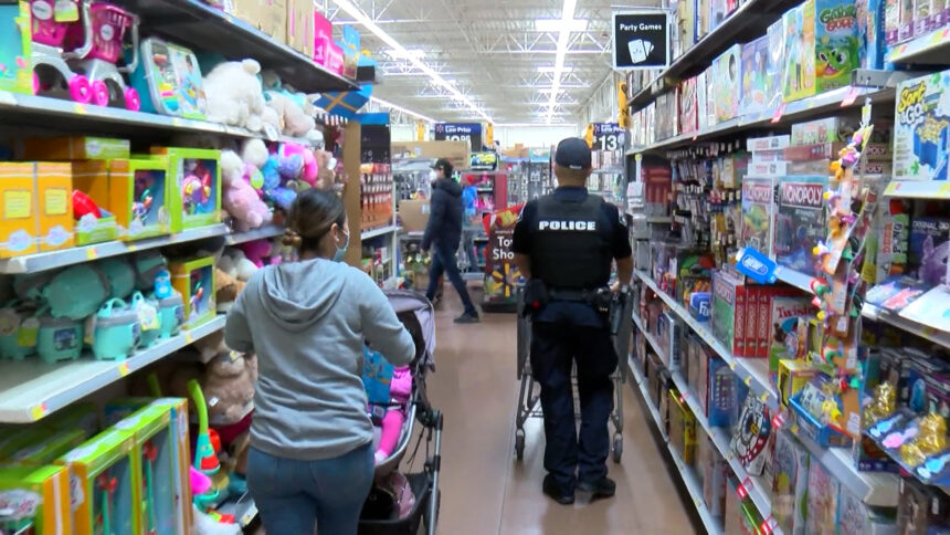 Shop with a Cop_SLPD brings kids to Walmart for shopping spree.mp4.00_00_39_11.Still001