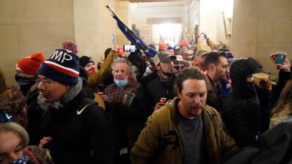 210107111828-01-rioters-inside-capitol-hallway-0106-live-video