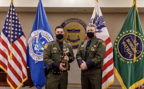 Border Patrol Agent C. Lara is presented with the Newton-Azrak Award.