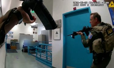 Body-camera footage shows law enforcement officers approach gunman Samuel Cassidy's body shortly after
