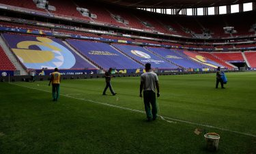 Employees prepare the National Stadium for the Copa America soccer tournament in Brasilia