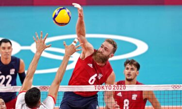 U.S. middle blocker Mitchell Stahl skies for a kill Wednesday against Tunisia at the Tokyo Olympics.