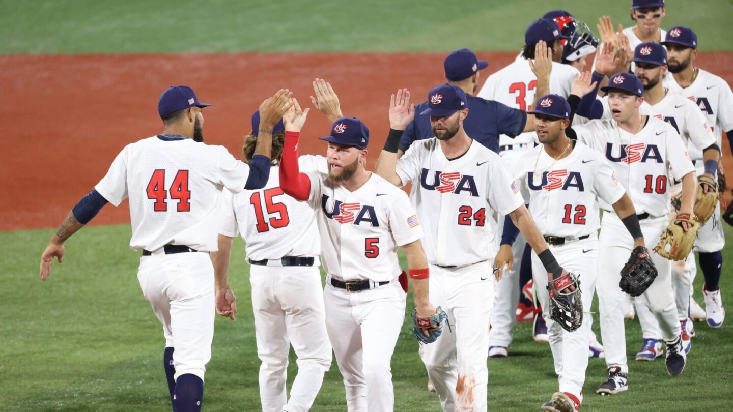 Simeon Woods Richardson #44 and Eric Filia #5 of Team United States celebrate with teammates after winning 4-1 during the baseball opening round Group B game against South Korea.