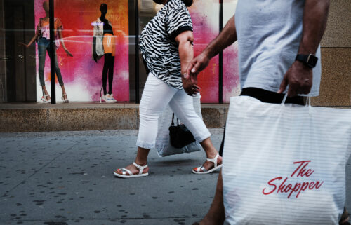 People walk through a shopping district in Brooklyn on July 16 in New York City. As demand for goods remains strong