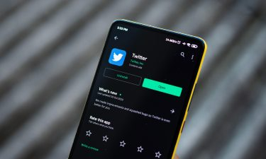 India's government says Twitter should be held liable for what users post. A person opens the twitter app on their phone in Assam