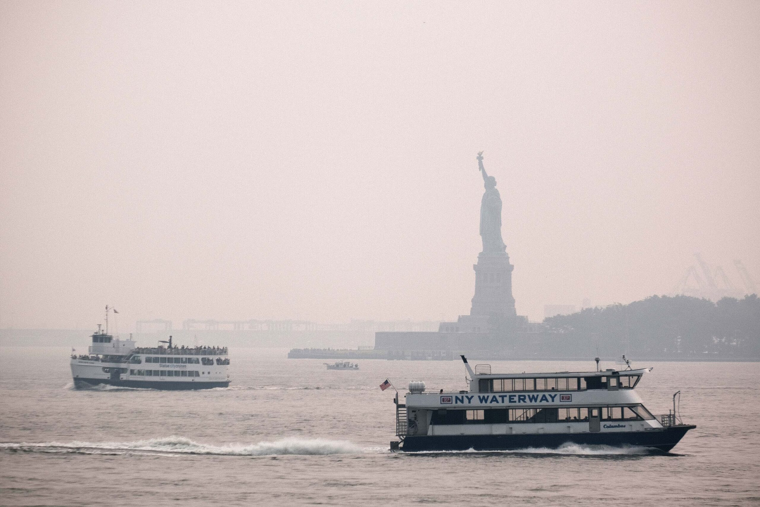 <i>Spencer Platt/Getty Images</i><br/>The Statue of Liberty sits behind a cloud of haze on July 20