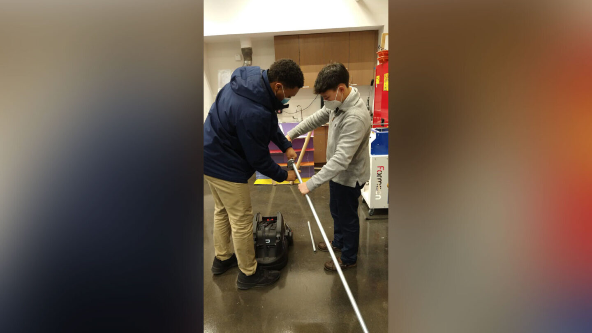 <i>Courtesy Matt Zigler</i><br/>Students Jewel Walker and Evan Beach are seen working on the WheeStroll Wheelchair Stroller Attachment.
