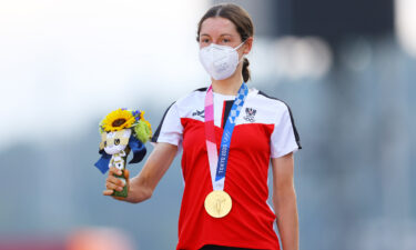Anna Kiesenhofer of Team Austria poses with the gold medal after day two of the Tokyo 2020 Olympic Games at Fuji International Speedway on July 25 in Oyama