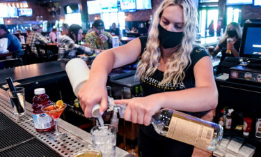Bartender Olivia Imes prepares a drink for a customer at P.J. Whelihan's restaurant and pub in Spring Township