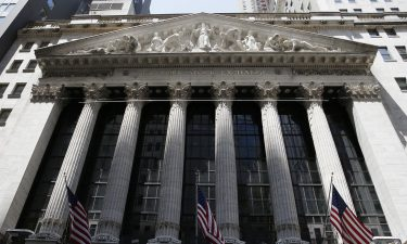 American flags hang outside of the New York Stock in the early afternoon at the NYSE on Wall Street in New York City on June 21. On July 6