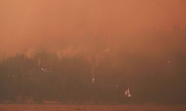 Heavy smoke and flames on the west side of Butte Valley Reservoir from the Dixie fire in Plumas County