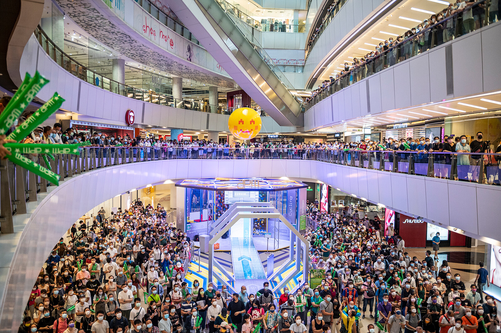 <i>Vernon Yuen/NurPhoto/AP</i><br/>People are shown at a shopping mall in Hong Kong watching Siobhan Haughey swim in the 100-meter freestyle Olympics final on Friday. Hong Kong police have arrested a man after he allegedly booed the Chinese national anthem while watching an Olympics award ceremony inside a shopping mall..