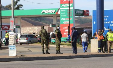 eSwatini soldiers and police officers are seen on the streets near the Oshoek Border Post between Eswatini and South Africa on July 1.