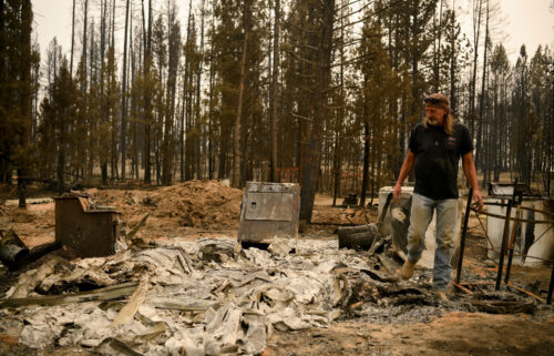Scott Griffin surveys his property which was destroyed by the Bootleg Fire