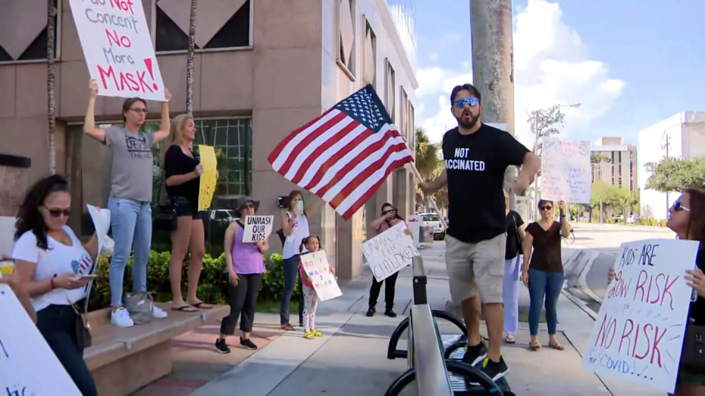 <i>WFOR</i><br/>Anti-mask protesters gathered at the Broward School Board headquarters before a board meeting in Fort Lauderdale