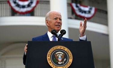 US President Joe Biden gestures as he speaks on the South Lawn of the White House in Washington