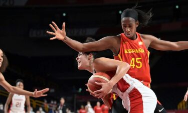 Spain takes down Canada to stay unbeaten in group stage