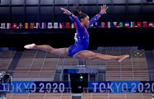 Simone Biles in the air during Olympic competition