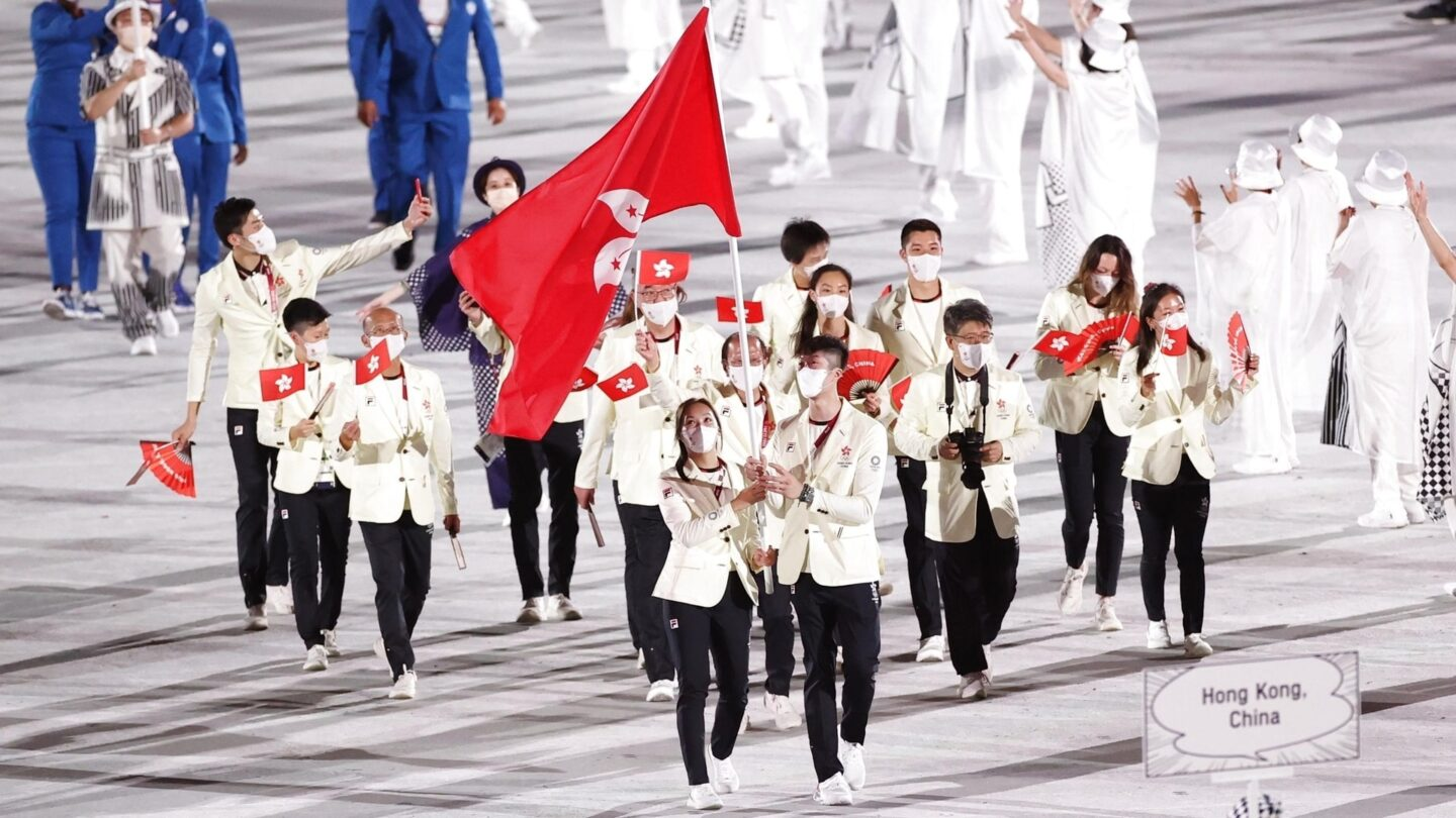 The Olympic delegation of Hong Kong parades into the Olympic Stadium
