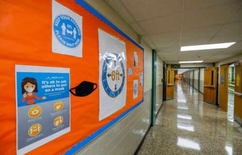 Signs continue to encourage mask wearing and social distancing for the upcoming fall semester despite ventilation improvements at Kelley Lake Elementary School in Decatur