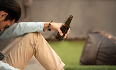 Some college freshman boys hide that they are failing and turn to drinking and smoking.