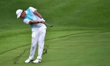 Hideki Matsuyama sticks his approach on the Par-4 12th hole
