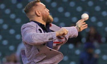 Conor McGregor throws out his first pitch at Wrigley Field.