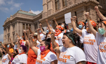 A federal judge set a hearing date for October 1 to consider a request from the Justice Department to freeze a Texas law that bars most abortions after six weeks of pregnancy