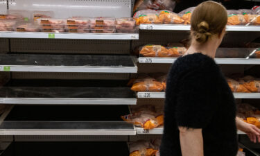 Shelves usually stocked with chicken stand empty at an Asda supermarket on September 19 in London.