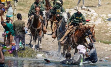 United States Border Patrol agents on horseback tries to stop Haitian migrants from entering an encampment on the banks of the Rio Grande near the Acuna Del Rio International Bridge in Del Rio