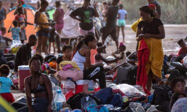Migrants under the international bridge at a camp on the U.S.-Mexico border on Sept. 21