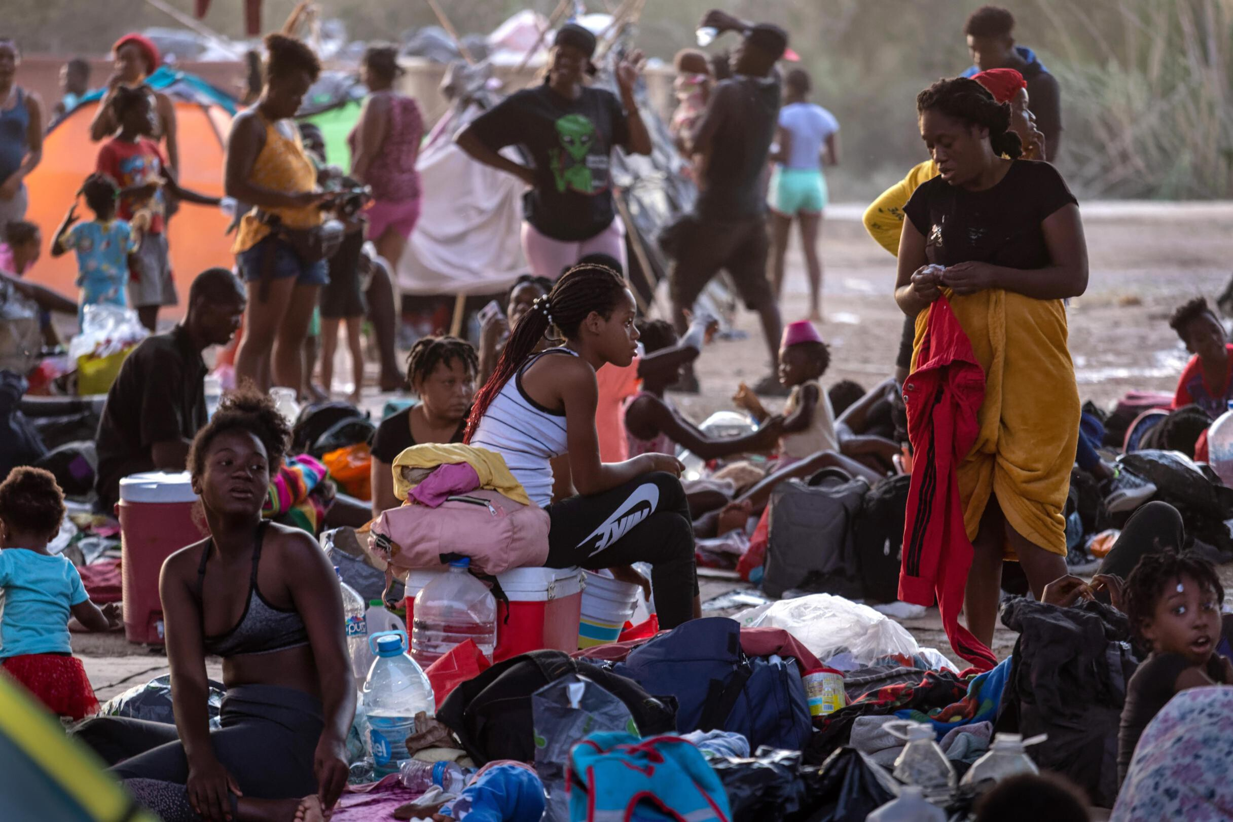 <i>John Moore/Getty Images</i><br/>Migrants under the international bridge at a camp on the U.S.-Mexico border on Sept. 21