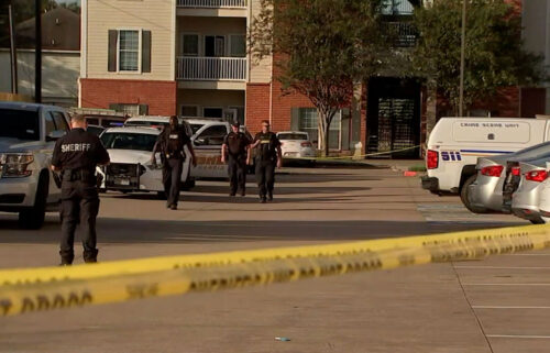 Police are seen at the Houston apartment complex where the children were found. The mother and boyfriend are facing charges.