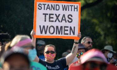 The Department of Justice will ask the Supreme Court to step in and block a controversial Texas law that bars most abortions after six weeks of pregnancy. Demonstrators are shown here rallying against anti-abortion and voter suppression laws at the Texas State Capitol on October 2